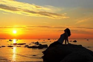 bigstock-Watching-The-Sunset-49666673